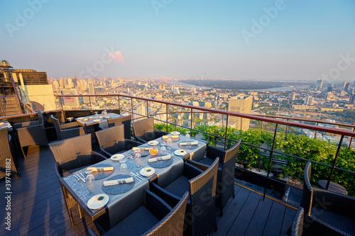 Table setting on roof top restaurant with megapolis view, Bangkok Thailand Fototapeta