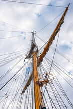 View From Below On The Mast Of A Large Sailing Ship Against The Sky With Clouds