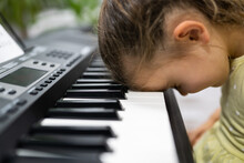 Tired Sad Frustrated Unhappy Child Girl Playing Piano Keyboard