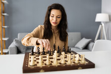 Woman Playing Chess Online