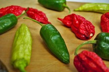 Fresh Jalapeno Habanero And Banana Pepper On A Wood Background