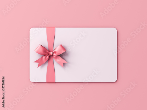 Blank white gift card or gift voucher with pink ribbon bow isolated on pink pastel color background with shadow minimal concept 3D rendering © masterzphotofo