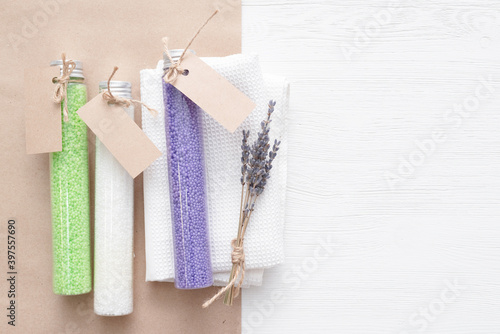 Fotografiet Various bath salt in the test tubes on the white background