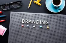 Branding Text On Modern Desk.business Creativity.