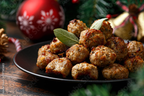 Obraz Christmas Pork stuffing meatballs with sage and onion. decoration, gifts, green tree branch on wooden rustic table - fototapety do salonu