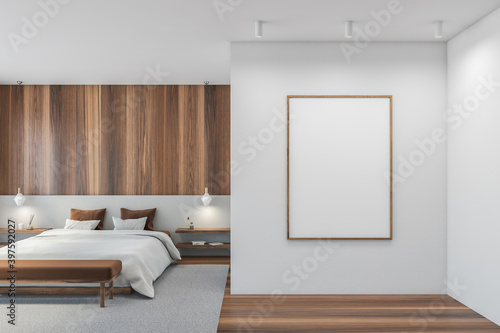 Obraz Mockup blank frame in wooden and white bedroom, big bed with linens - fototapety do salonu