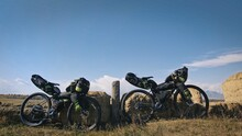 The Mixed Terrain Cycle Touring Bike With Bikepacking. The Travel Journey With Light Bicycle Bags Designed Or Modified For Cycling. The Trip On Multitrack Bike, Outdoor Road In Mountain Snow Capped.