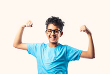 Successful Little Indian Asian Cute Boy With Glasses Against White Background