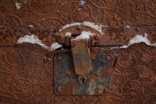 Metal Lock Or Hinge Of An Old Metal Crate Or Box With Nice Vintage Style Carvings On The Surface.