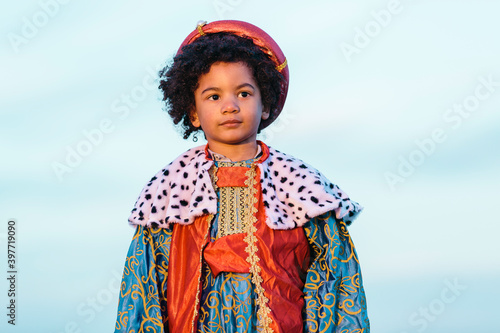 Fotografiet Black child with afro hair, dressed in a wise man's costume