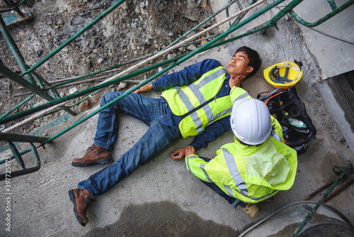 Check Response and pulse, Life-saving, and rescue methods. Builder accident falls scaffolding on floor, Safety team helps employee accident. First aid support accident in Construction work.