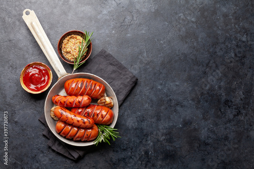 Fototapeta Hot grilled sausages in a frying pan obraz