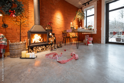 Fotomural Fireplace area of a beautiful loft-style interior with real brick and concrete floors decorated for the New Year holidays