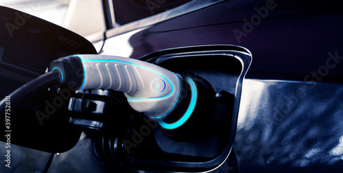 Power cable pump plug in charging power to electric vehicle EV car with modern t Wallpaper Mural