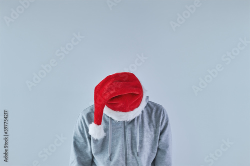 Depressed and sad man with Santa Claus hat looking down Wallpaper Mural