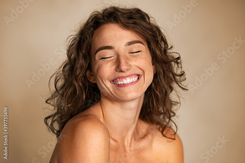Natural beauty woman laughing with joy - fototapety na wymiar