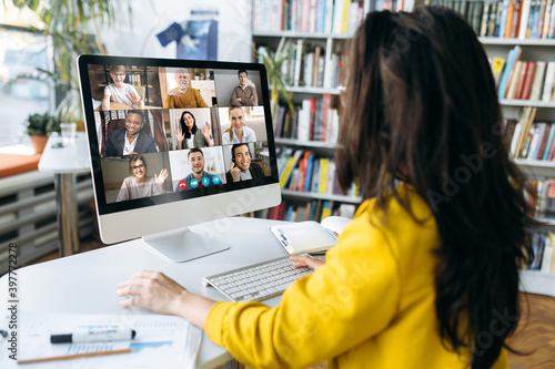 Fototapeta Multiracial business people gathered together in online video conference talk di