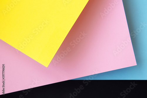 Fototapeta Abstraction from multicolored paper backgrounds with contrasting shadows