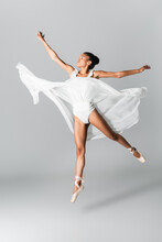 Graceful African American Ballerina In Dress Dancing On White Background