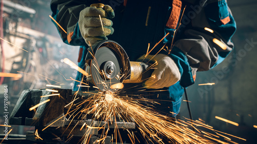 Fotografia, Obraz Locksmith in special clothes and goggles works in production