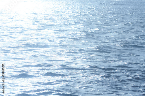 Obraz Blue sunlight reflecting in glittering sea. sparkling in water - fototapety do salonu