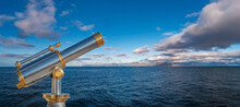 Banner With An Old Telescope Looking Towards Dreams And Adventures, At Blue Sky And Ocean, With Copy Space For Text. Concept Travel, Freedom And Adventure, Nomadic Lifestyle.