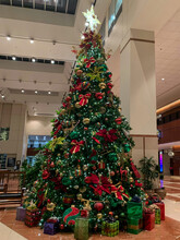 A Huge Christmas Tree In Office Lobby