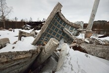 Dramatic Sky With Dark Clouds Above The Ruins Of An Old Building, Exterior Details, Columns Close-up. Traditional Soviet Architecture, Past, History. Economic Decline In Russia. Winter Cityscape
