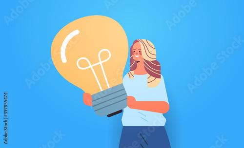 Fototapeta woman hr manager holding light bulb creative management concept horizontal portrait vector illustration obraz
