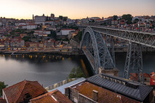 Tram And Pedestrians Cross The Ponte Luis In Porto