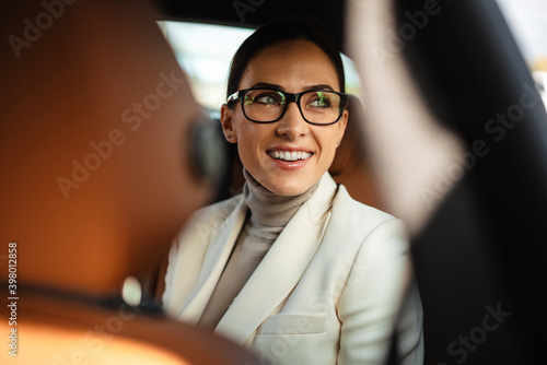 Fototapeta Positive pleased business woman sitting in a car obraz