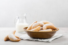 Homemade Crescents Stuffed With Walnuts And Choccolate And Milk. White Background. Copy Space.