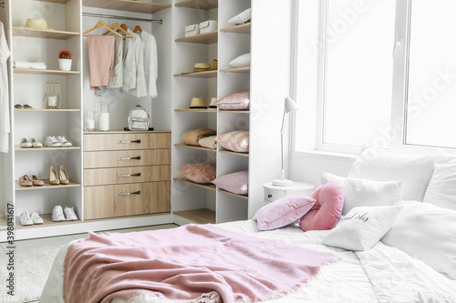 Fotografie, Obraz Big wardrobe with different clothes and accessories in bedroom