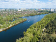 Aerial drone view. A motor boat sails down the river on a sunny day.