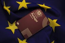 Portuguese Passport On European Union Flag Background