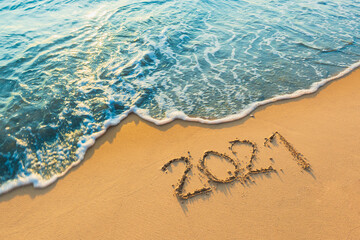 2021 on the beach happy new year on nature background