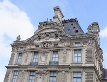 The Louvre.The Facade Of The Flora Pavilion Is Decorated With High Reliefs Of The Triumph Of Flora.The Author Of Them -the French Sculptor Jean-Baptiste Carp.