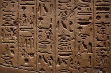 Ancient Egyptian Hieroglyphics Carved On A Stone Wall