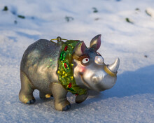 Silver Christmas Toy Rhinoceros In The Snow Closeup