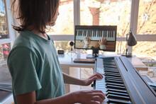 Young Boy Having Online Piano Class. Home Education.