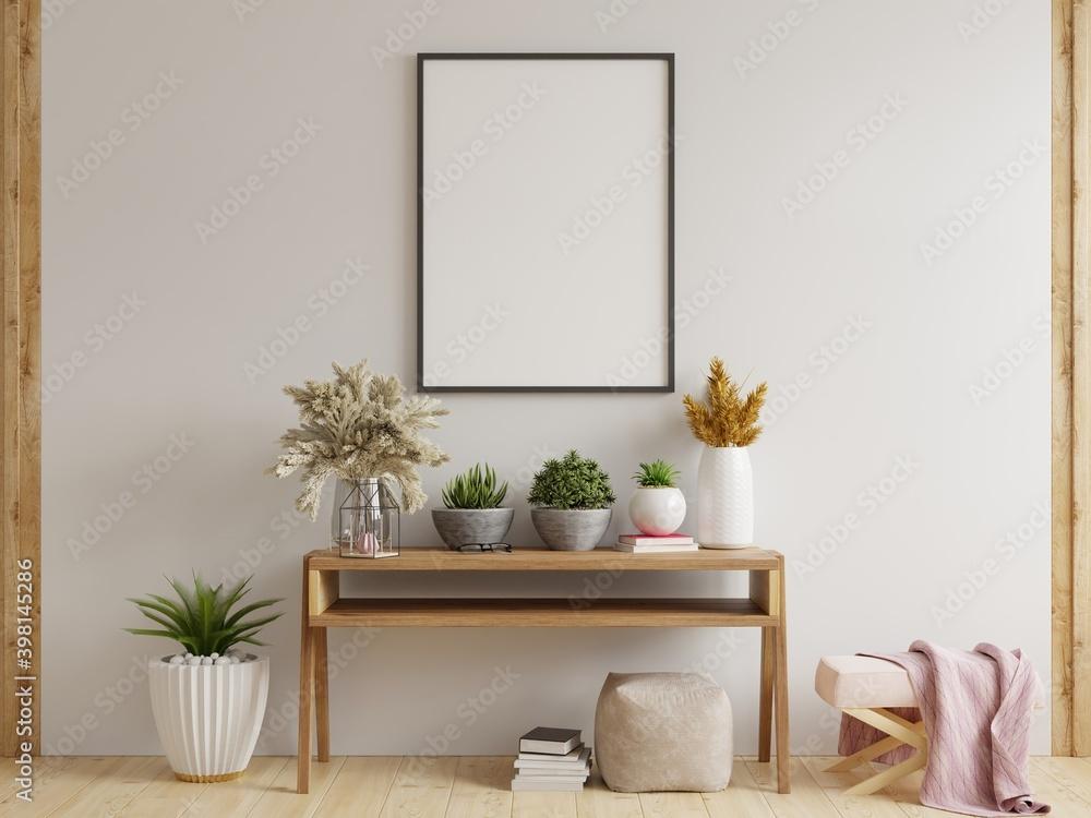 Fototapeta Mock up poster frame on cabinet in interior.