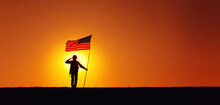 Silhouette Of USA Armed Forces Soldier, Army Infantryman Or Marine Corps Fighter Saluting While Standing With Waving National Flag On Sunset Background. Military Victory And Glory, Fallen Remembrance