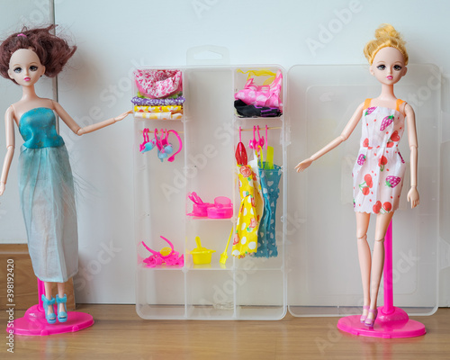 Doll set with cupboard full of accessories and clothes. фототапет