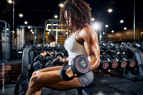 Fototapeta Well-built young bodybuilder doing the strength workout obraz