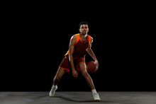 Leader. Young Purposeful African-amrican Basketball Player Training, Practicing In Action, Motion Isolated On Black Background. Concept Of Sport, Movement, Energy And Dynamic, Healthy Lifestyle.