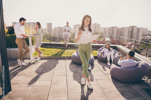 Obraz Nice stylish entrepreneurs leaders spending time gathering company culture communication on roof outside outdoor sunny day - fototapety do salonu