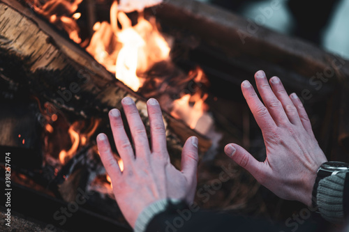 Fototapeta Warming hands on the bonfire