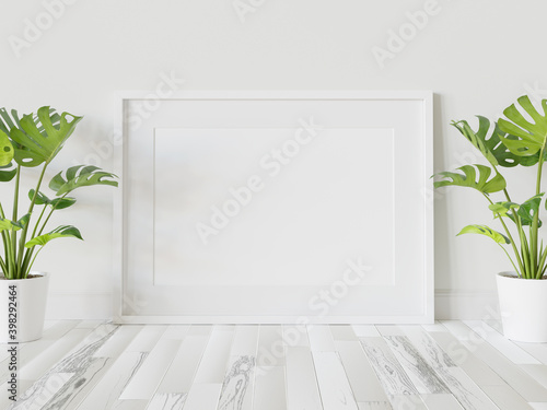 Fototapeta White frame leaning on floor in interior mockup. Template of a picture framed on a wall 3D rendering obraz