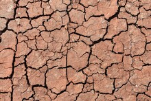 The Texture Of Cracked Earth Dried River Bed After A Hot Summer.