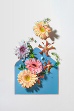 Blue Envelope With Spring Flowers.